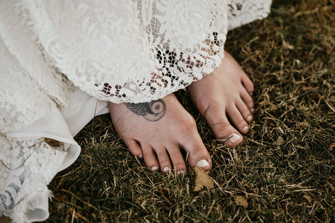A barefoot bride enjoying the grass beneath her feet during their adventure elopement to Denmark.