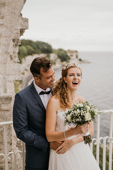A couple enjoying their civil wedding abroad at the ancient UNESCO Hojerup church after booking a destination wedding packages with Nordic Adventure Weddings.