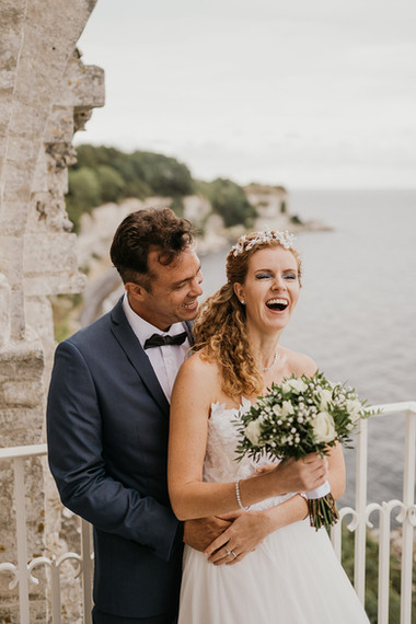 A groom hugging his bride and smiling while getting married in Denmark, made possible by booking by our elopement wedding packages.