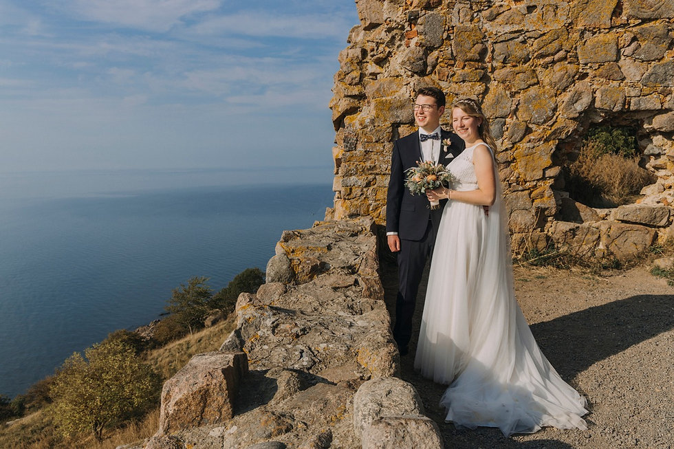 Newlyweds looking to Baltic Sea during their romantic adventure elopement in Denmark