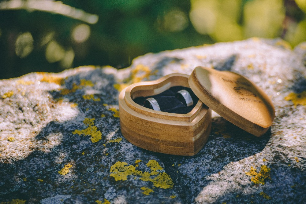 Wedding rings in a romantic wooden box, on the stone