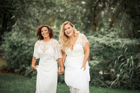 A lesbian couple during their same-sex wedding in Denmark, after booking our beach wedding venue.