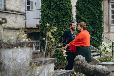A couple enjoying their vows renewal abroad experience in a Denmark castle courtyard, great for Denmark weddings as well.