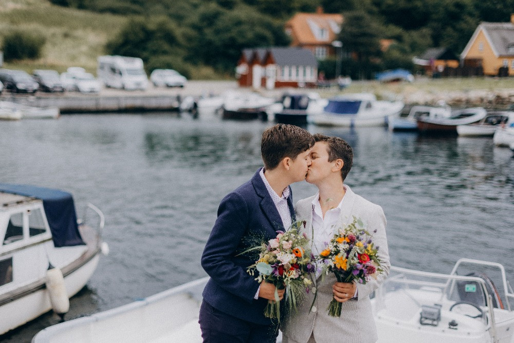 Same sex lesbian couple kissing at their wedding day in Denmark
