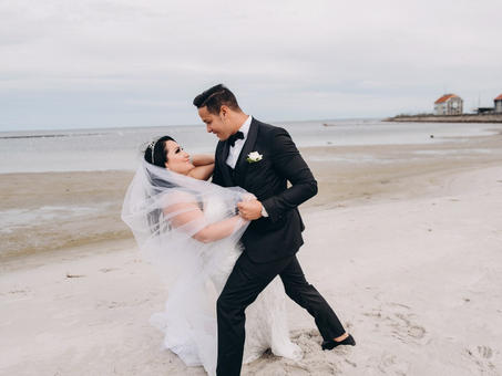A couple dancing on the quiet Nordic beach during their marriage island adventure beach wedding abroad.