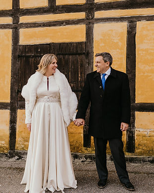 Newlyweds holding hands during their wedding abroad in Denmark after booking one of our wedding packages abroad for two for their intimate wedding abroad.