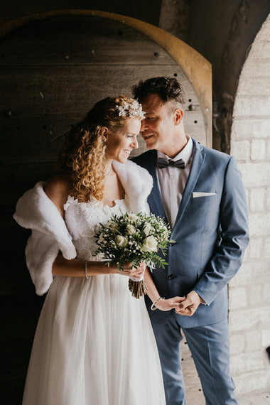 A romantic portrait of newlyweds in the ancient church during their wedding abroad in Denmark.