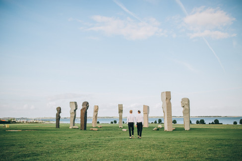 A gay couple at the Dodecalith in Denmark during their same-sex wedding abroad adventure