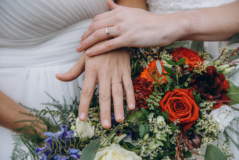 A lesbian couple's rings and bouquets after booking our Denmark wedding package for an LGBT wedding abroad.