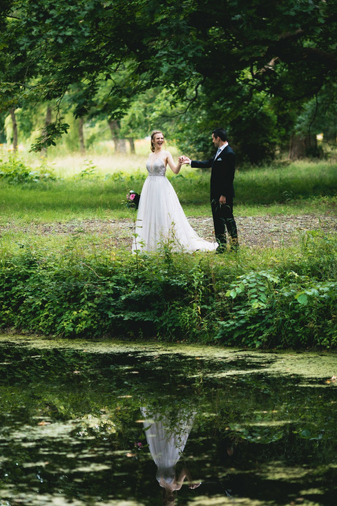 A romantic moment between husband and wife during their castle wedding adventure elopement in Denmark, exploring the natural courtyard nearby.