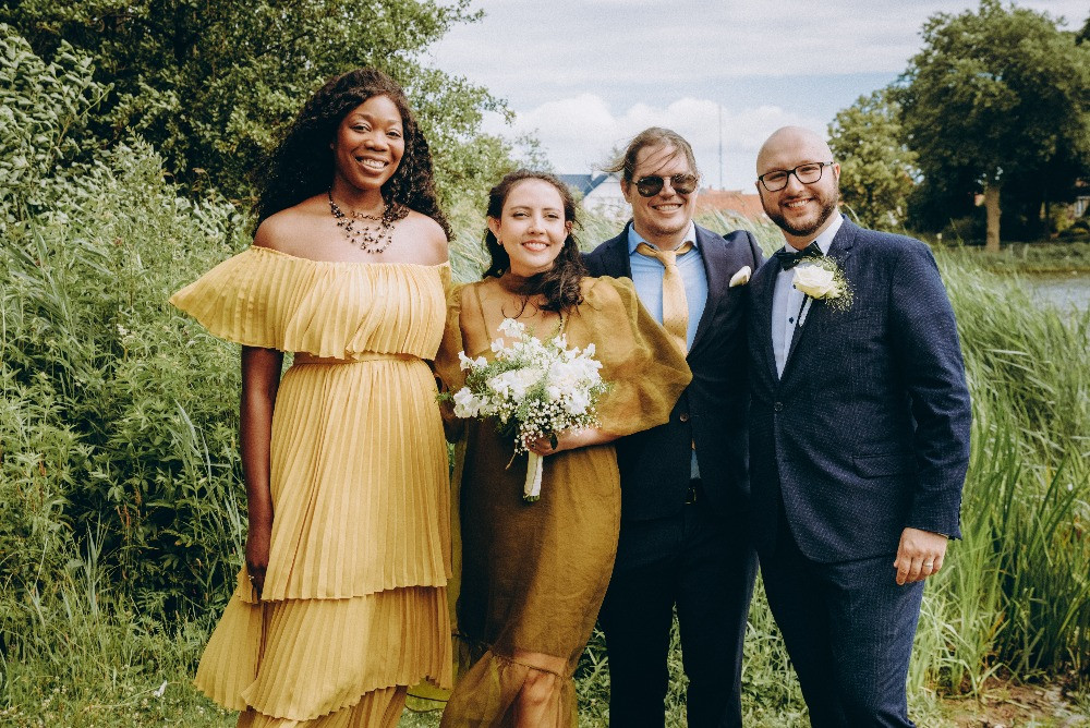 Newly weds posing with friends at their small elopement wedding in Denmark