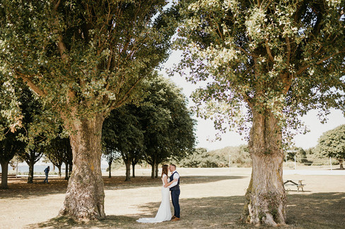 A romantic moment between newlyweds at the park after booking our Denmark marriage packages for Lolland Island.