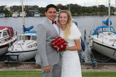 Newlyweds at the marina as they enjoy their Scandinavian intimate wedding in Denmark