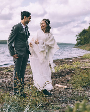 Newlyweds laughing during their adventure destination wedding on the bridal islands of Denmark.