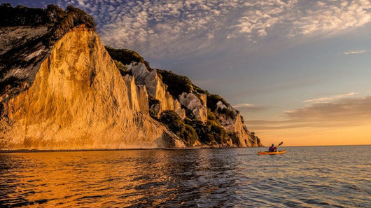 The majestic chalk cliffs during sunset at Møn Island, a romantic destination wedding location in Denmark.
