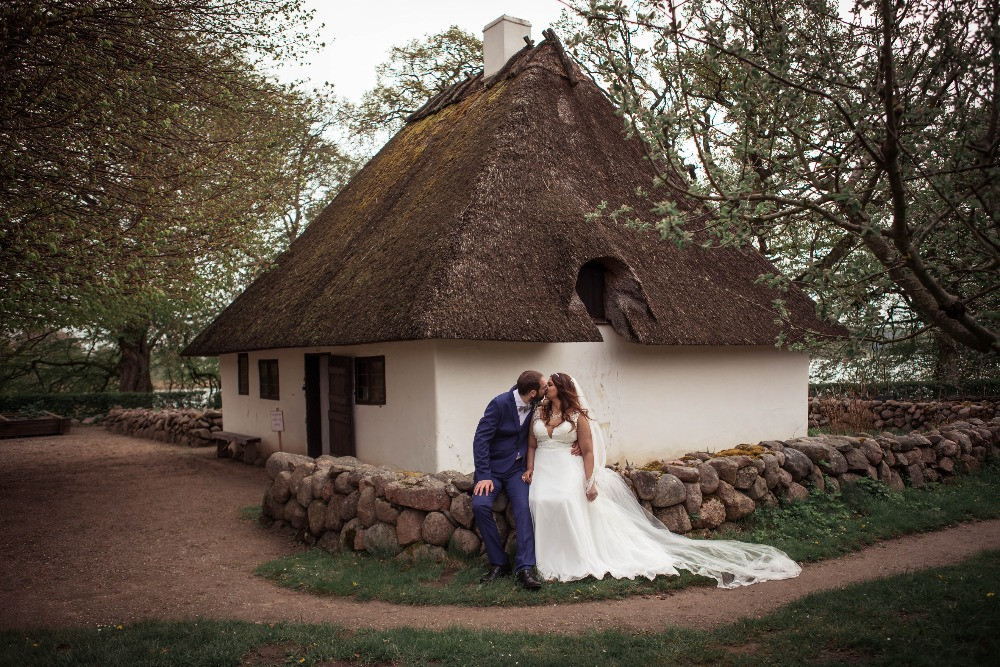 A couple kissing during their adventure elopement in Denmark in Maribo open air museum