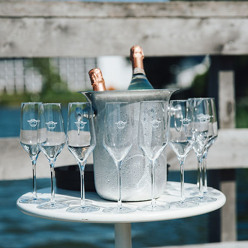 Champagne and glasses for a small destination wedding toast, small details that wedding abroad planners take into consideration.