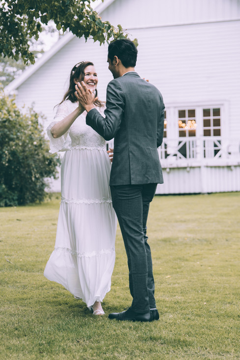 Newlyweds dancing during their Scandinavian wedding in Denmark, one of the best places to elope.