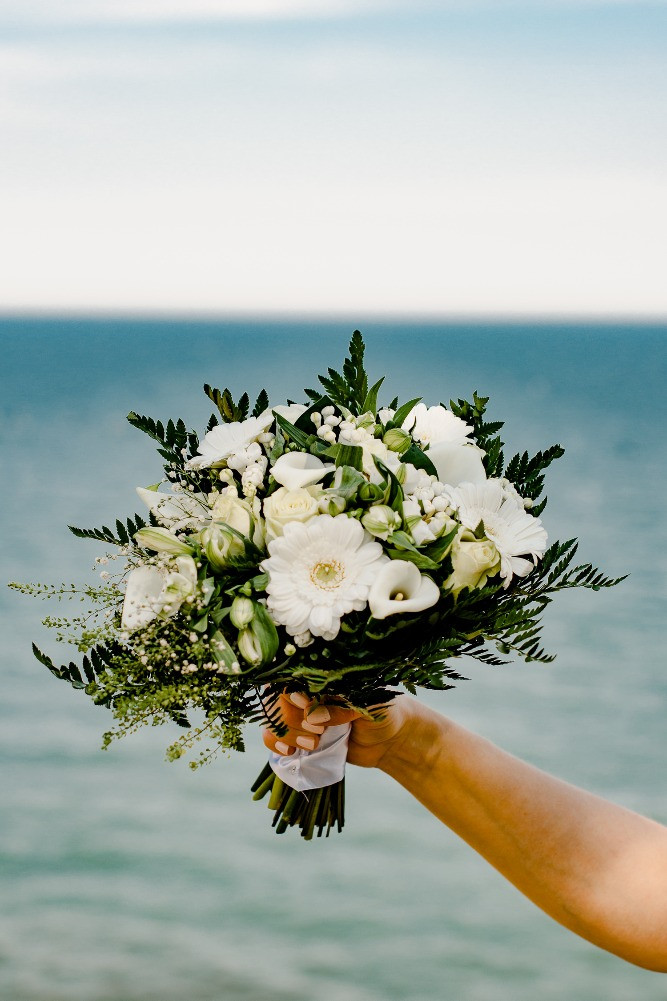A local wedding bouquet in the white and yellow colors