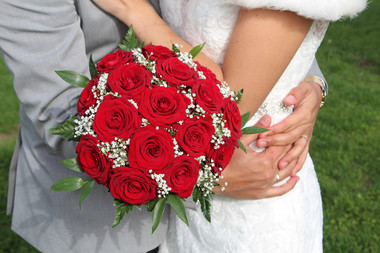 A bouquet of roses, one of the many details we arrange in our Denmark elopement packages abroad.