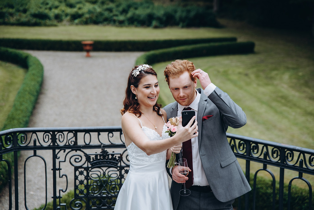 A couple making selfy during their adventure wedding in Denmark