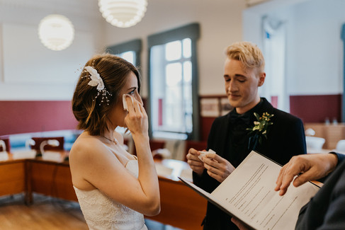Husband and wife being emotional during their Scandinavian wedding in Denmark, pictured during their town hall wedding