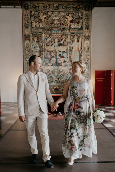 Newlyweds enjoying their wedding in Denmark in the castle in Hamlet's Elsinore Castle