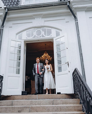 A young couple at the Vindeholme Castle during their adventure elopement to Denmark, enjoying their intimate wedding venue abroad