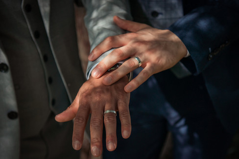 A pair of hands and wedding bands, pictured in Denmark during a wedding package abroad for two adventure.