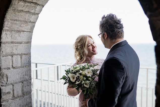 Newlyweds during their Nordic wedding at Stevens Klint, the old Hojerup Church, a marry abroad idea for history lovers.