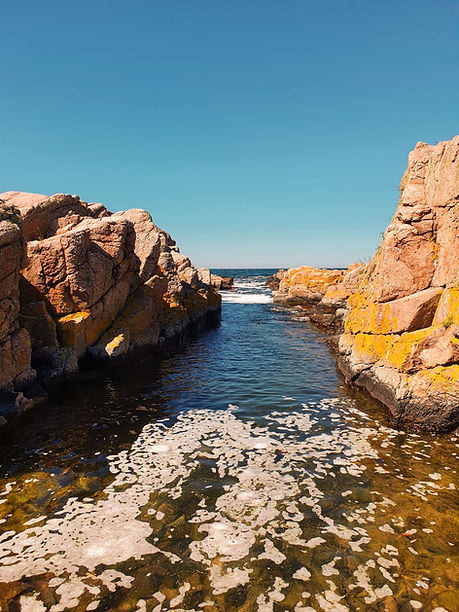 Bornholm Island's coastline, a laid-back elopement abroad destination for couples dreaming of an adventure wedding.