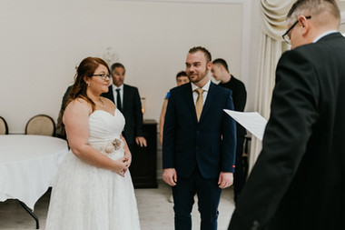 A couple during their elopement in Denmark listening to their wedding vows
