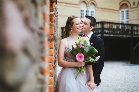 Newlyweds kissing during their castle wedding abroad in Denmark on Lolland Island, one of the best places to get married abroad for intimate weddings.