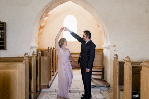 Tetiana and Jakub dancing in the ancient church, a perfect marry abroad idea for history lovers dreaming of a wedding abroad in Denmark.