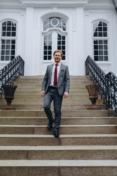 A groom's portrait during his Denmark wedding abroad at the Vindeholme Castle, a top wedding venue included in our wedding packages abroad for two.