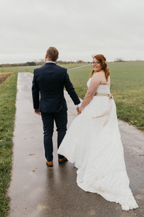 a-groom-holds-a-bride-whule-walking-on-the-road