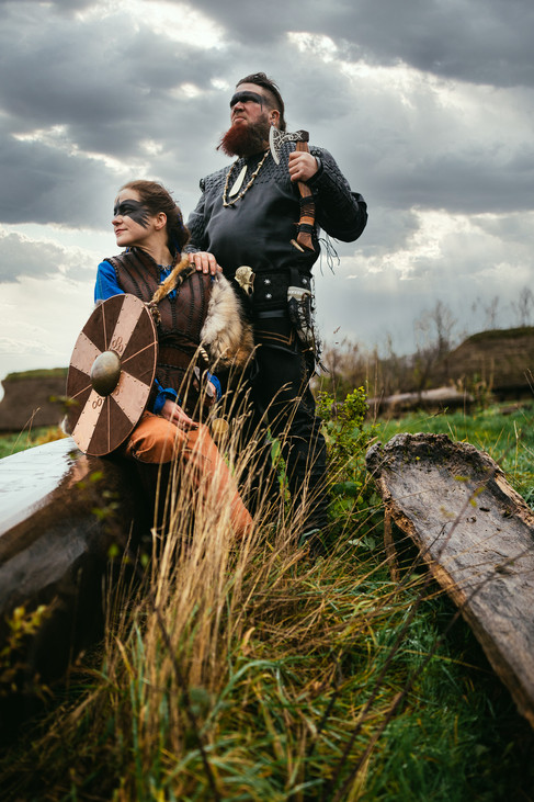 Newlyweds looking ahead at the horizon during their adventure elopement and viking-themed wedding.