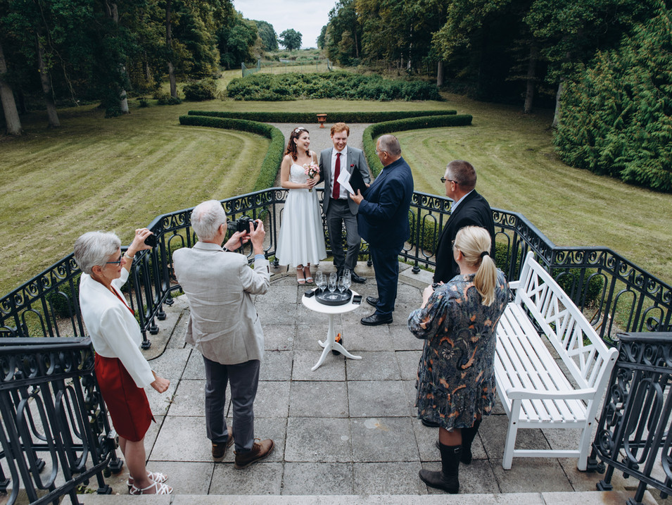 A marriage in Denmark taking  place at Vindeholme Castle's courtyard.