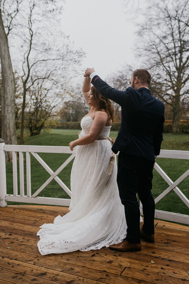 Newlyweds dancing during their Nordic wedding in Maribo town as they enjoy their elopement in Denmark.
