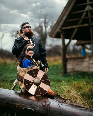 A couple getting married inspired by traditional Viking culture made possible by our Denmark elopement packages