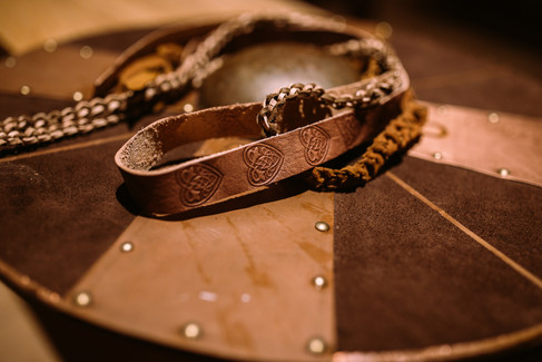 A close-up of the leather ropes used in handfasting ceremonies for traditional Scandinavian weddings.