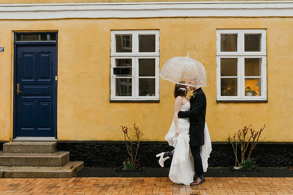 A couple kissing on the street of Maribo, the wedding town in Denmark
