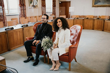 The couple embracing during their civil town hall marriage in Denmark.