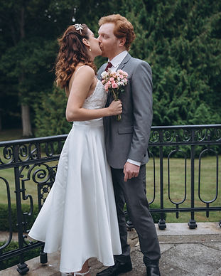 Newlyweds kissing at the Vindeholme Castle after their romantic wedding ceremony abroad in Denmark