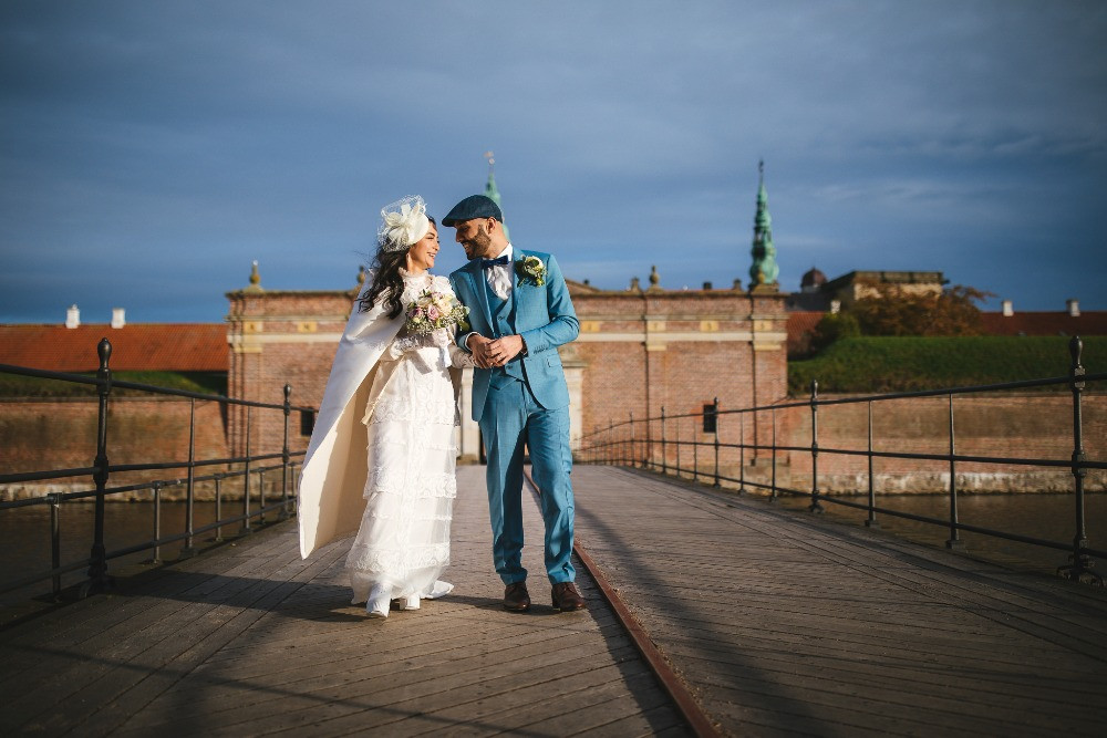 A happy couple just married in the Danish castle Kronborg
