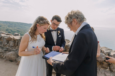 A wedding island ceremony at the Hammershus Ruins, one of our wedding packages abroad for two in Denmark.