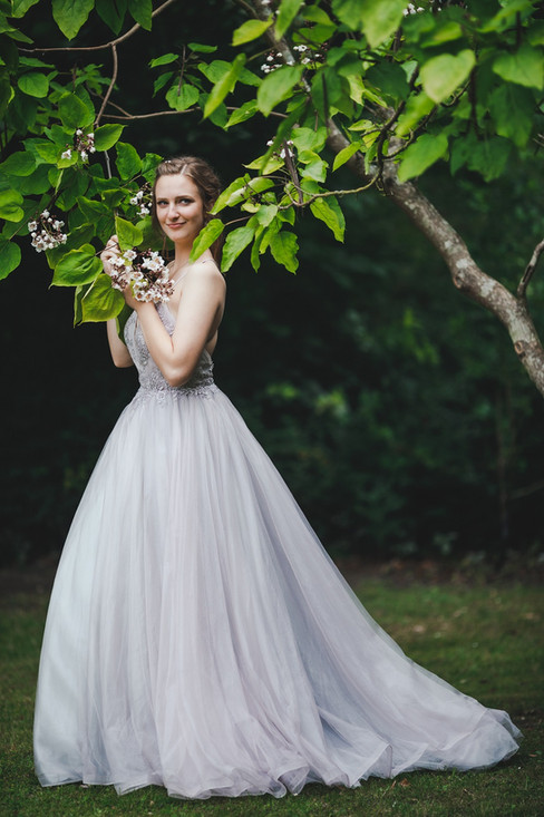 A romantic portrait of a bride during her Nordic wedding in Denmark on Lolland Island.