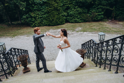 Newlyweds dancing during their castle wedding adventure at Vindeholme, one of the best Denmark wedding venues for small weddings abroad.