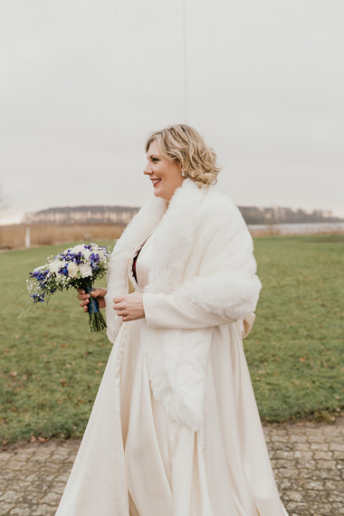 A bride smiling during her winter elopement to Lolland Island in Denmark a Scandinavian wedding.
