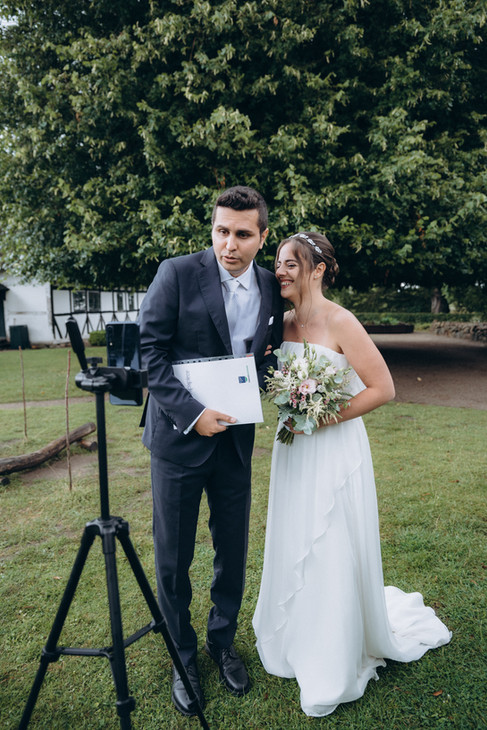 A couple speaking to the camera while being live so that their friends and family can tag along on their wedding abroad, one of the many benefits of an elopement in Denmark.
